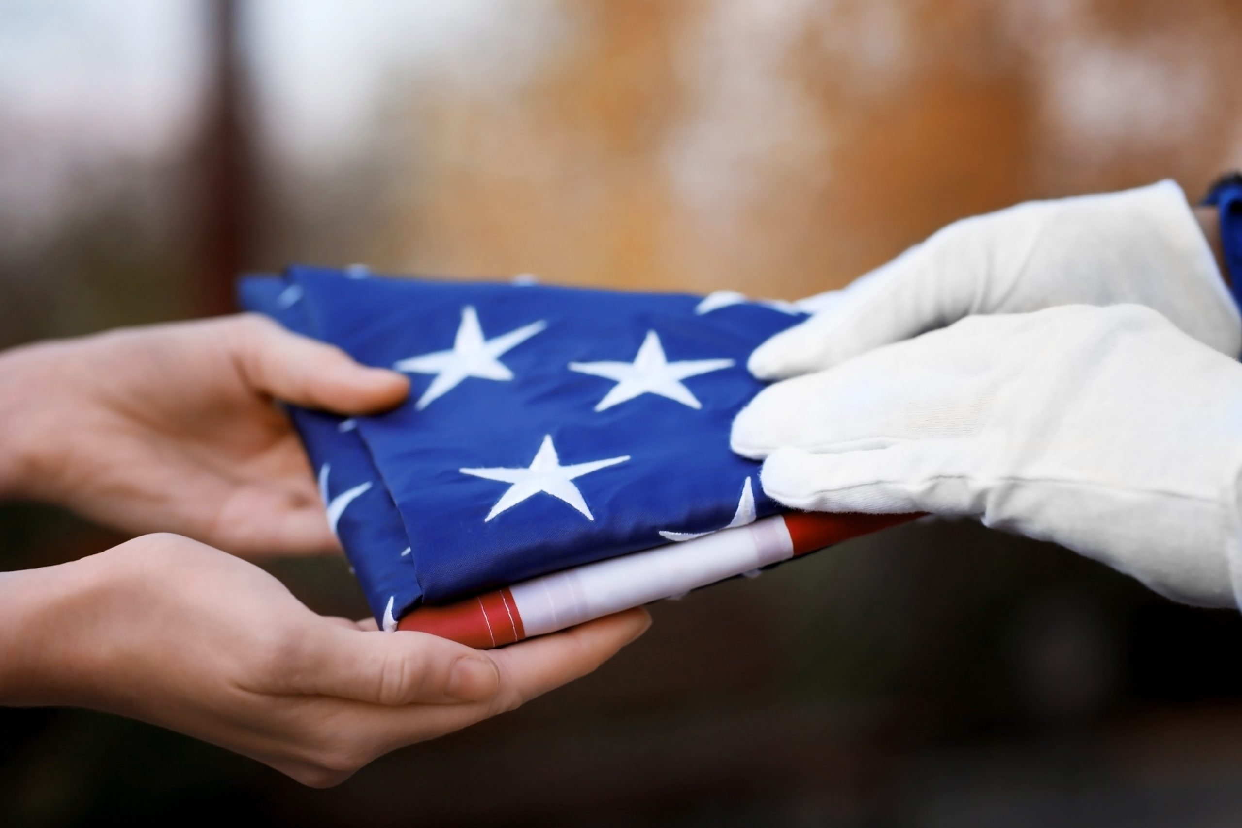 employee benefits death claims american flag folding